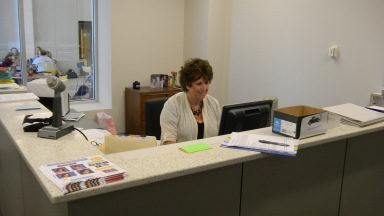 Mrs. Darlene Santel works at her desk, getting ready for a new day at MND