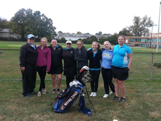 "JV coach, Kellie Kaiser, and JV golf team, Sydney Tiberghien, Henson Sullivan, Emily Webb, Mia Mendez, Casey Kowitz, Francine Gates, and Kylie Arbin (left to right) pose after their 2014 GGCL Tournament Sunday, October 5. Even with a predominantly freshman team, the team beat last year's records. Senior Emily Webb, who has played golf for MND for 4 years shares, ""I really enjoyed the enthusiasm that my team brought into every match. It made my senior year more enjoyable."""