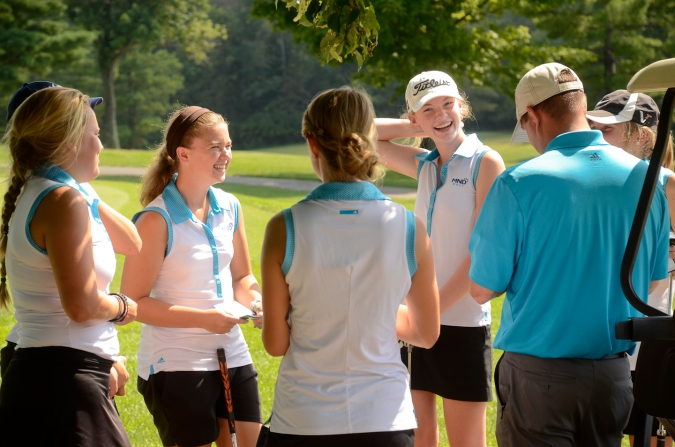 Sam Shinkle, Molly McCudden, Grace Weber, and Meghan Shea (left to right) listen attentively to Head Coach Andrew Horner before their match on September 9 and then burst into laughter as a joke is cracked. Despite Horner having a surgery half way through the season and taking recovery, the MND Varsity Golf team had a lot of fun and success this year! They advanced to districts as a team.