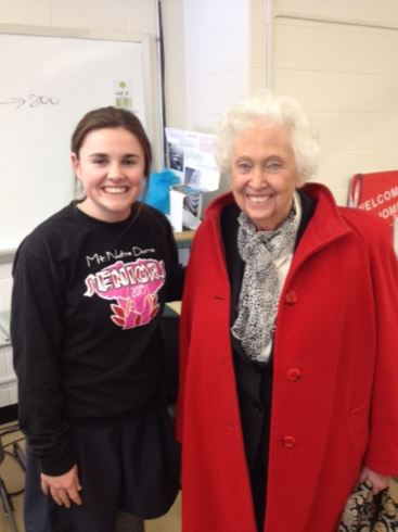 Kate Jennings '15 speaks with Marty Bartlett after senior citizens visit Mrs. Magnus's History of the 60s class on Thursday, February 5. Bartlett, who studied engineering at Purdue, gives encouragement to Jennings who will embark on the same path this Fall. Jennings shares,
