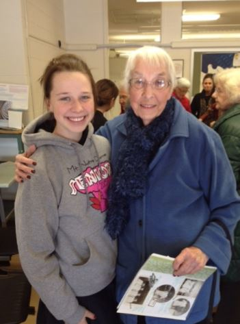 Ali Staun '15 speaks with Ann Reed after senior citizens visit Mrs. Magnus's History of the 60s class on Thursday, February 5. Reed, who studied nursing at Xavier discusses with Ali how nursing has changed over the years. Ali shares,