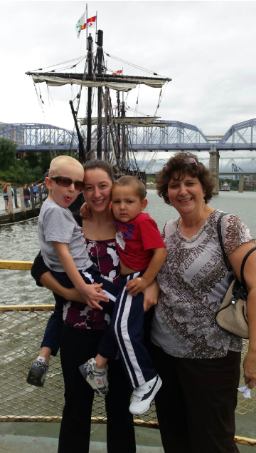 Mrs. Gerwe and her youngest daughter, Julia, visit Newport with her other daughter's grandchildren, Nick and Joe. The four enjoyed the beautiful view of the Nina and the Pinta docked in the Ohio River.
