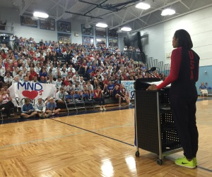 """Olympic medalist, Rachael Adams, speaks to the MND community about her journey to success. Adams played volleyball while attending MND, graduated in 2008, and continued her education and volleyball career at Texas University. Adams said, """"""""You guys see me. I have a medal on. I have 'USA' on my chest, and I'm an Olympian. But it wasn't always easy for me,"""" to explain to the students that even Olympians go through tough times.  Photo: Karen Day"""